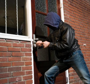 man-breaking-into-home
