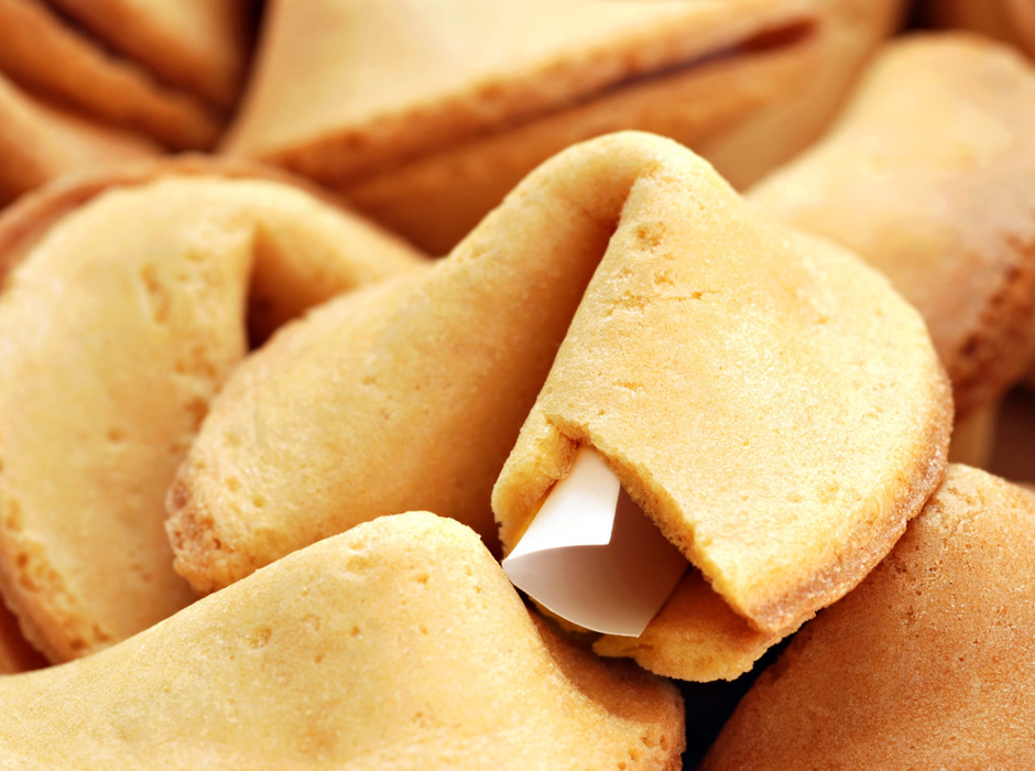 Fortune cookie background.  Macro with shallow dof.  Selective focus on edge of opened cookie with paper strip.; Shutterstock ID 101825749; PO: The Huffington Post; Job: The Huffington Post; Client: The Huffington Post; Other: The Huffington Post